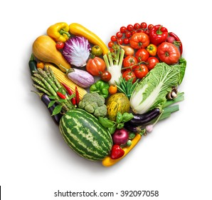 Heart symbol. Vegetables diet concept. Food photography of heart made from different vegetables isolated white background. High resolution product
