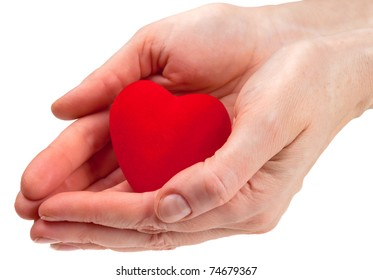 Heart symbol in woman hands isolated on white