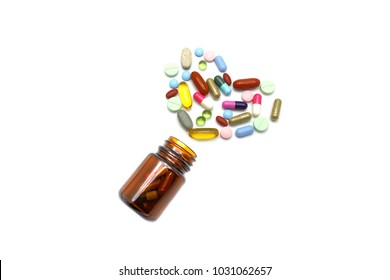 Heart from tablets and capsules of medicine pills, Vitamins and Herbs with glass bottle isolated on white background with copy space for text. Alternative choice  health product modern life concept.