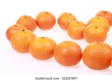 Heart of tangerines on a white background