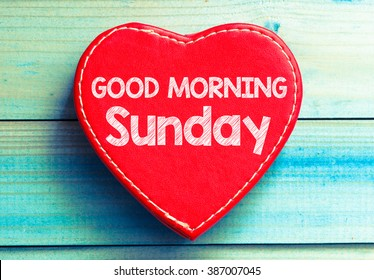 Heart with text Good morning Sunday. Heart with text Good morning Sunday on a wooden background. Vintage style.
