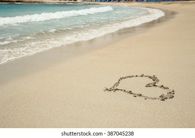 a heart trace in the sand seashore