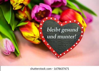 Heart with tulips (bleibt gesund und munter :stay alive and well) Health wishes by postcard