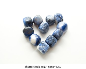 Heart of Tumbled jasper stones for crystal therapy treatments and reiki close up