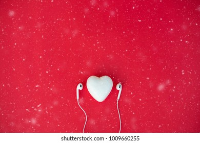 Heart wear headphones On the red background.