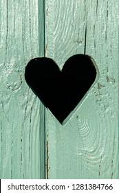 heart in a wooden door