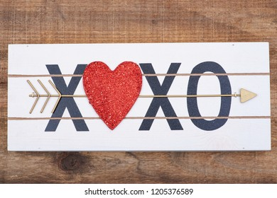 Heart xoxo hugs and kisses sign on wooden background