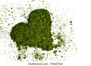 Heart from young barley or wheat grass isolated on white background. Detox superfood.