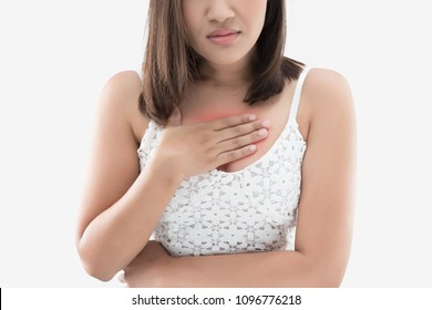 Heartburn is a feeling of burning in people chest, and is a symptom of Acid reflux or GERD. A woman suffering from heartburn on a gray background.