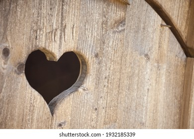 hearth shape over a wooden balcony in a small alpine cabine