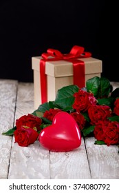 hearts and a bouquet of red roses on wooden board, Valentines Day background