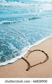hearts drawn on the sand of the beach