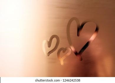 Hearts drawn on a sweaty mirror. Romantic background. Love store