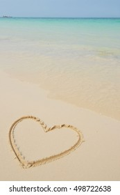 Hearts drawn in the sand on the beach.