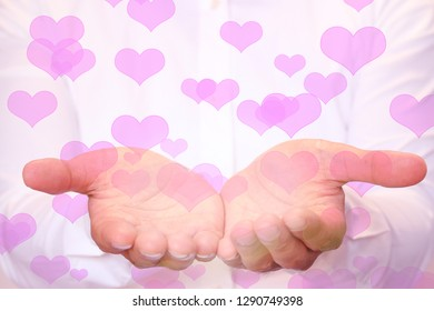 hearts falling on hands