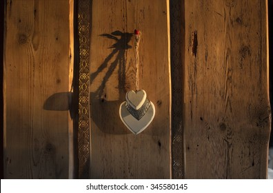 Hearts hanging on the door made of old wooden planks