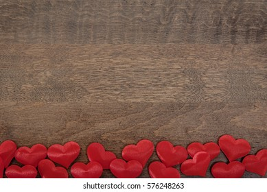 Hearts horizontal flat lay with a wooden background