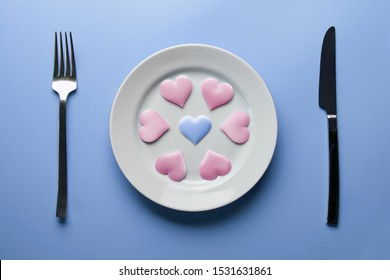 Hearts on plate. Woman and men love flirt. Choice among different sex partners. New girlfriend or boyfriend. Promiscuity and polygamy concept.
