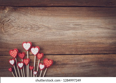 hearts on sticks flat lay on wooden board with space for text for valentines or mothers day
