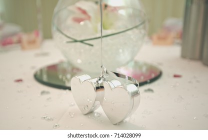 Hearts on the table during wedding.