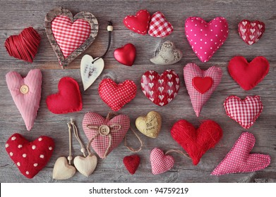 A lot of hearts on wooden background