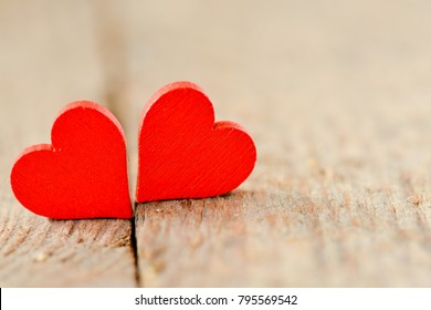 Hearts on a wooden background. Background in the style of Valentine's Day. Hearts on a wooden background