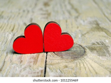 Hearts on a wooden background. Hearts symbol of love. Valentine's Day.