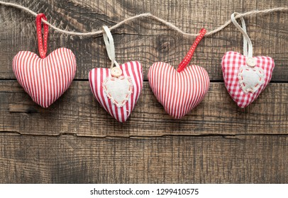 Hearts on wooden background.Valentines day greeting card.Top view with copy space