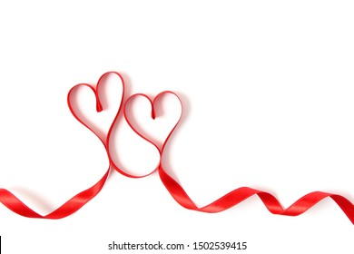 hearts from ribbons on a white background top view.