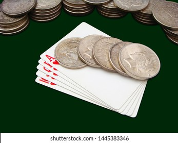 Hearts Royal Flush With Many Stacks Of Morgan And Peace Type Silver Dollars Over Green Background
