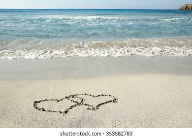a hearts in the sand on the beach
