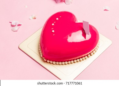 Heart-shape Mousse Cake on Red and Blue Background with Beautiful Hydrangea.