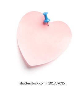 Heart-shaped adhesive note isolated on white background
