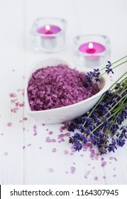 Heart-shaped bowl with sea salt  and fresh lavender flowers on a wooden  background