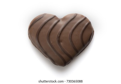 A heart-shaped chocolate-covered european wafer cookie.
