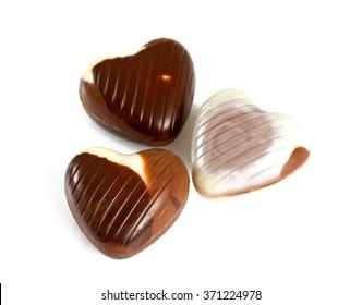 heart-shaped chocolates isolated on white
