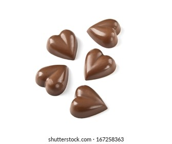Heart-shaped chocolates on white background