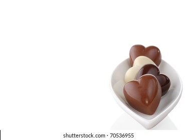 Heart-Shaped Chocolates in a White Dish with Room for Text for Valentine's Day