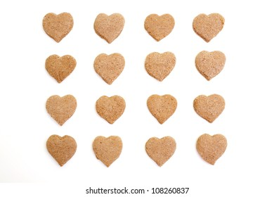 heart-shaped cinnamon cookies isolated on white background