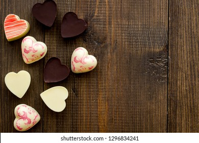 Heart-shaped confection for Valentine's day on dark wooden background top view copy space