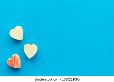 Heart-shaped confection for Valentine's day on blue background top view space for text