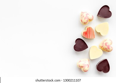 Heart-shaped confection for Valentine's day on white background top view copy space