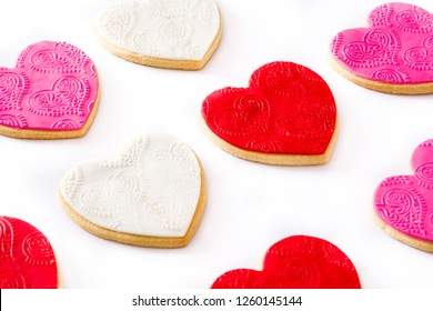 Heart-shaped cookies for Valentine's Day isolated on white background. Top view.