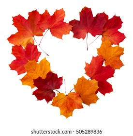 Heart-shaped frame of colorful maple leaves isolated.