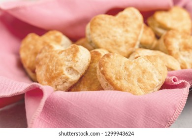 Heart-Shaped Homemade Biscuits on Gray Background with Pink Napkin