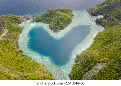 A heart-shaped lagoon is found amid remote limestone islands in Raja Ampat, Indonesia. This amazing area is known for its spectacular marine biodiversity.