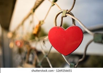 Heart-shaped love lock hanging on a bridge in Tel Aviv, Israel. Valentine's Day background.