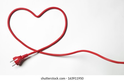 Heartshaped red cable on white background