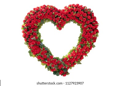Heart-shaped red roses isolated from white background.