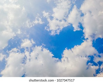 Heart-shaped sky.blue sky background. Clouds in the sky